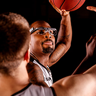 Picture of a man playing basketball while wearing an eyetracker